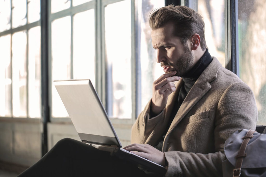 man looking confused on laptop